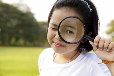 Girl with magnifying glass Image courtesy of Naypong / FreeDigitalPhotos.net