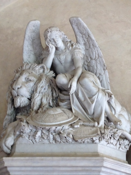 Here a not very happy angel, waiting for you to finish writing the next novel Might feed you to the lion if you don't get done soon!