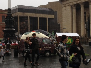 Christmas pudding on wheels in front of Sheffield's City Hall