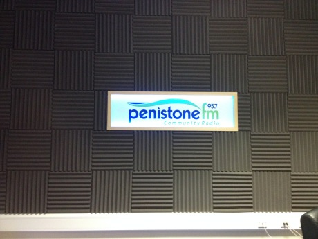 The logo of Penistone FM in situ, inside of the studio